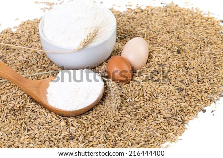 Whole flour with wheat ears and eggs. Isolated on a white background.  - stock photo