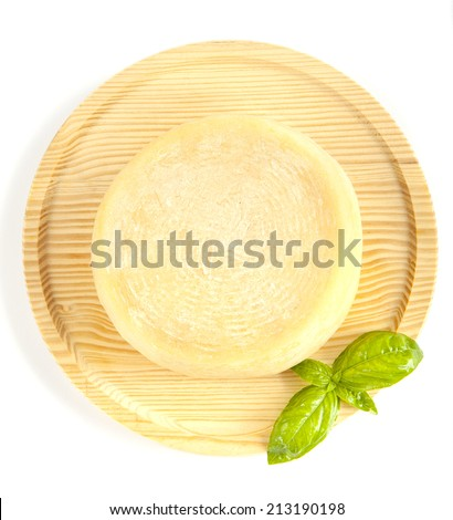 whole form of cheese parmesan. with fresh basil. on wooden plate. on white. italian pecorino - stock photo