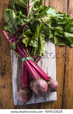 Whole fresh beetroot on wooden table, from local vegetable market. - stock photo