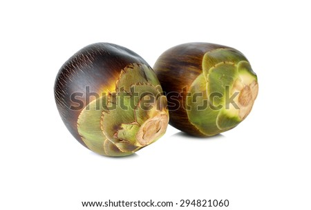 whole fresh toddy palm fruit on white background
