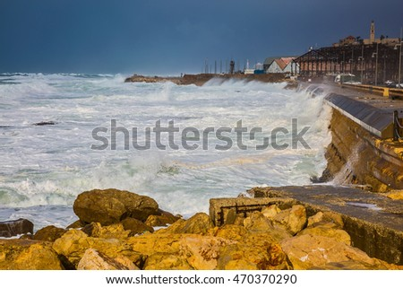 Whole gale in the Mediterranean Sea. Huge foamy waves fight about the coast. New Quay in the Old Jaffa, Israel