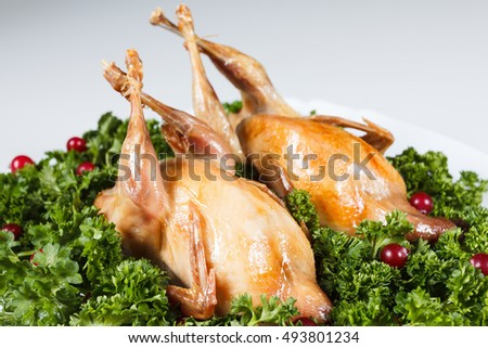Whole gamebird roasted with sweet and sour cranberry sauce and parsley