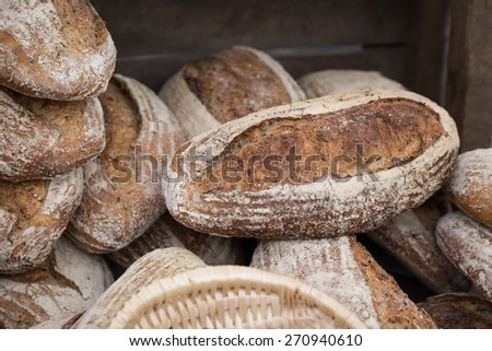 Whole Grain Bread Loaves in a Food Market. - stock photo