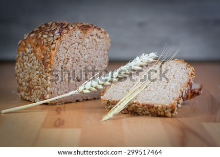 Whole grain bread with sunflower - stock photo