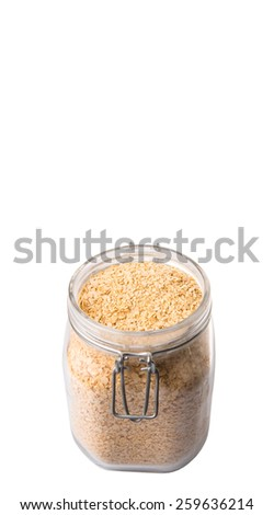 Whole grain breakfast cereal in a glass jar over white background - stock photo
