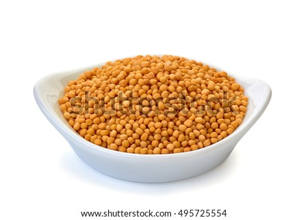 Whole grain mustard in bowl on white