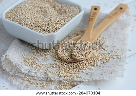 Whole Grain Quinoa on Bamboo Spoons - stock photo