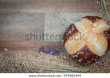 Whole grain roll with wheat seeds - stock photo