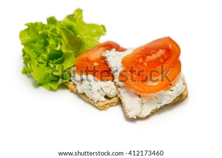 whole grain sandwiches with cheese and tomatoes on the white background - stock photo