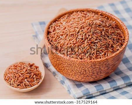 Whole grain Traditional Thai rice best rice for healthy and clean food in coconut wooden bowl . - stock photo