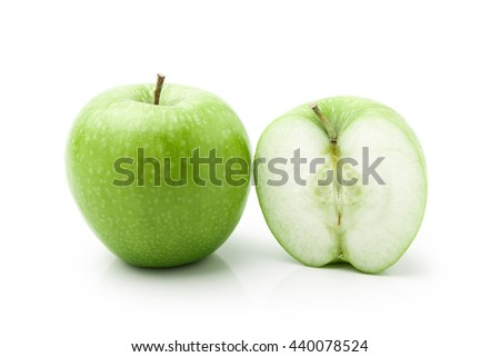 Whole green apple and half  on white background