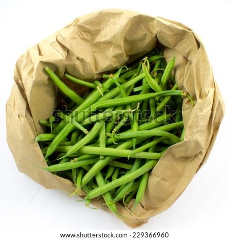 Whole green beans in a paper bag - stock photo