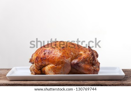 whole grilled chicken on wood - stock photo