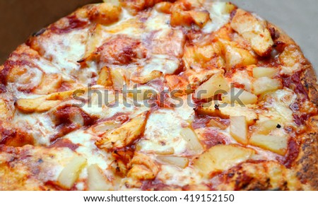 Whole Hawaiian pizza with pineapple and chicken