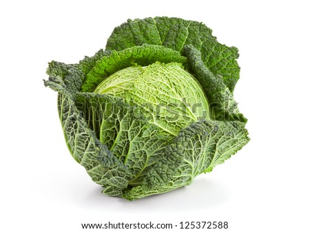 Whole head of savoy cabbage over white background - stock photo