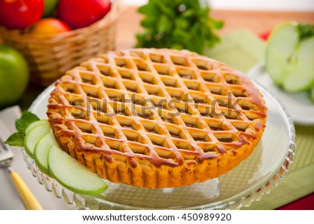Whole homemade fresh apple pie tart golden crust fruit filled delicious dessert - stock photo