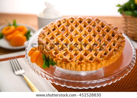 Whole homemade fresh apricot peach pie tart golden crust fruit filled delicious dessert - stock photo