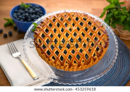 Whole homemade fresh blueberry organic pie tart golden crust fruit filled delicious dessert - stock photo