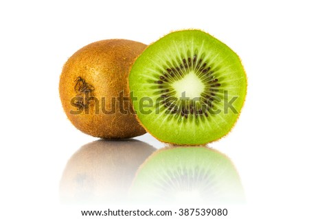 Whole kiwi fruit and a half placed next to it isolated on white background. All in focus using focus stacking technique - stock photo