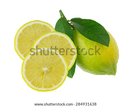 Whole lemon with green leaves and sliced against white background - stock photo