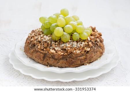 whole nut pie with grapes, horizontal - stock photo