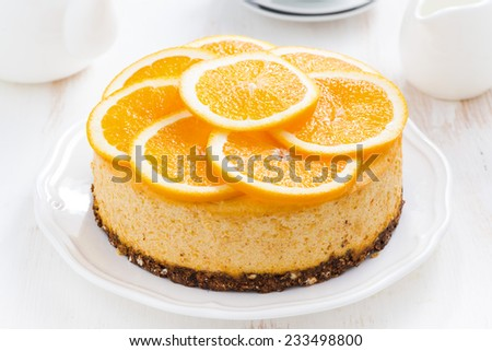whole orange cheesecake, top view, horizontal - stock photo
