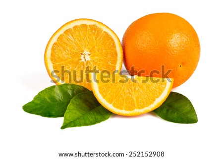 Whole orange, half an orange, orange slice in the peel on the green leaves on a white background - stock photo