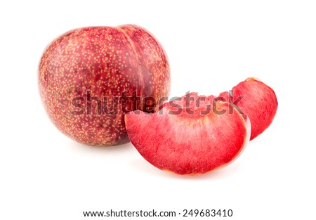 Whole plum with delicious juicy slices on white background. - stock photo
