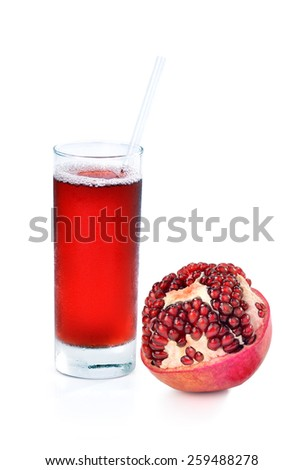 Whole pomegranate and glass of cold pomegranate juice on isolated white background, pomegranate and pomegranate juice on white background   - stock photo