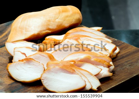 Whole pork ham and sliced ham - stock photo