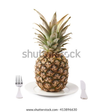 Whole raw fresh pineapple on plate isolated over white background - stock photo