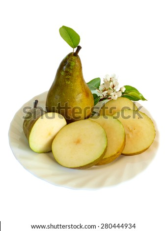Whole ripe pear, round slices and blossoms on dish, isolated on white       - stock photo