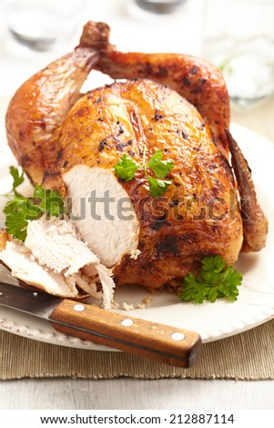 Whole Roasted Chicken on plate for holidays - stock photo