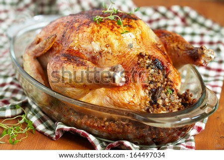 Whole roasted chicken stuffed with buckwheat and vegetables - stock photo