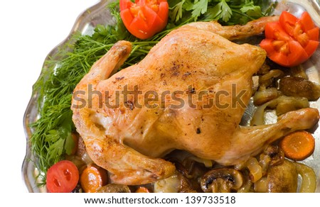 Whole roasted chicken with mushrooms  garnished with tomatoes