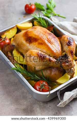 whole roasted chicken with vegetables, selective focus