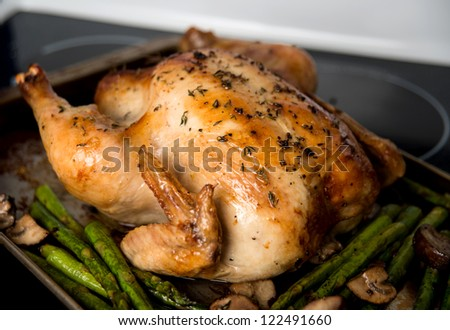 Whole Roasted Free Range Chicken Served wit Asparagus and Mushrooms - stock photo