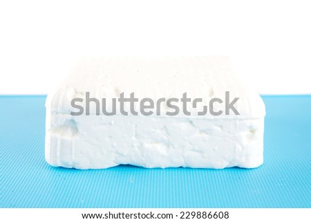 whole soft cheese on dishware isolated over white - stock photo