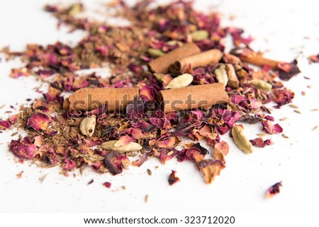 Whole Spices Mix with Dried Rose Petals, Allspice, Black Pepper, Cardamom, Turmeric, and Cinnamon - stock photo