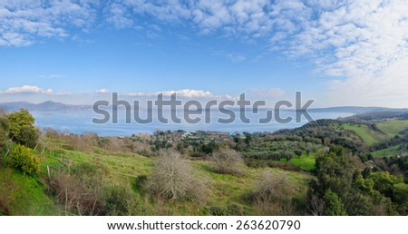 Whole view of Lake of bracciano. The lake is a volcanic origin crater lake and the second largest lake in Lazio, Italy. - stock photo