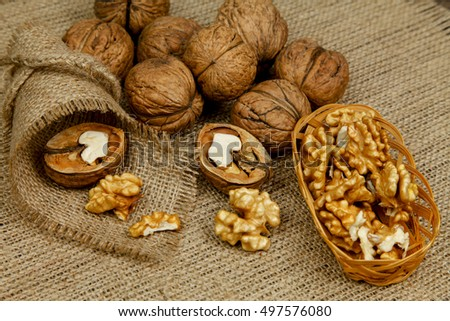 Whole walnuts and kernels on the table