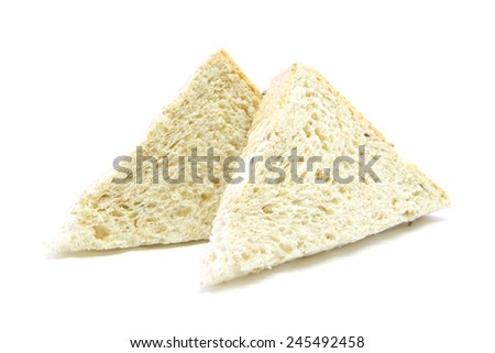Whole wheat and oat bread sandwich cut ingredient on white background - stock photo