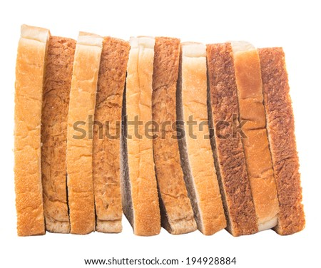 Whole wheat bread and sandwich bread over white background