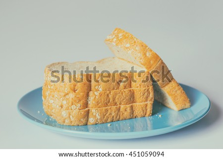 Whole wheat bread on a Blue Plate, Vintage Sweet Tone