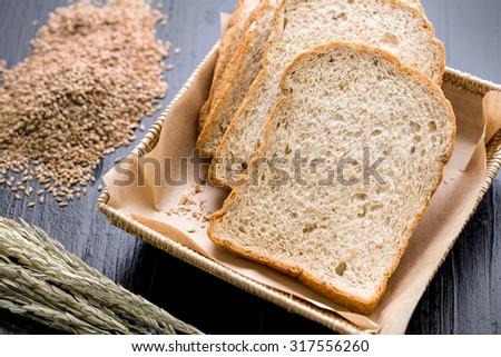 Whole Wheat Bread on Black Background - stock photo