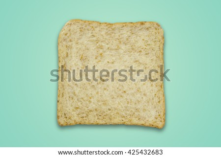 Whole wheat bread on color background / Whole wheat bread