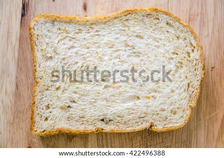 whole wheat bread on wooden background
