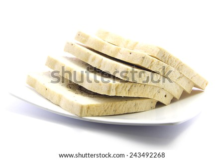 Whole wheat bread with banana sliced ingredient on white plate and white background - stock photo