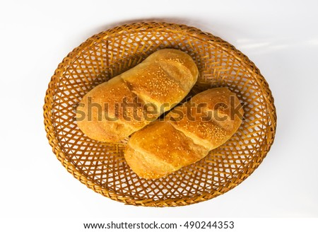 whole wheat breads on a wicker plate