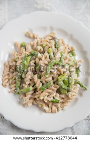 Whole wheat pasta with asparagus - stock photo
